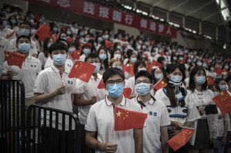 A group of seven thousand graduate students wear masks during the opening ceremony at Huazhong University of Science and Technology at the school's stadium on September 4 in Wuhan.