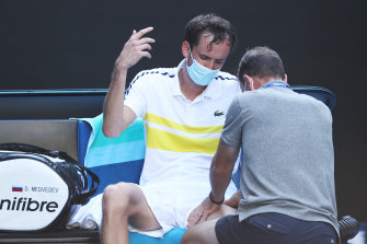 Daniil Medvedev of Russia receives treatment following victory.