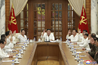 North Korean leader Kim Jong-un, centre, attends a meeting of his ruling party's political bureau in Pyongyang on Tuesday.
