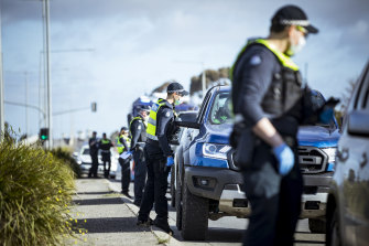 Police at a road stop on Somerton Road in Roxburgh Park on Thursday.