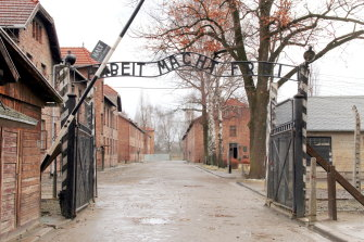 "The gates to the first Auschwitz camp, bearing the infamous legend <i>Arbeit Macht Frei</i> (""Work Sets You Free"")."