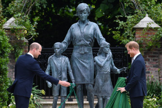 Prince William and Prince Harry take the covers off the new Kensington Palace statue.