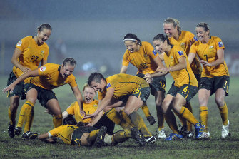 The Matildas celebrate after winning the Final match against North Korea for the AFC Women's Asian Cup 2010, played in Chengdu in southwest China's Sichuan province on Sunday, May 30, 2010.