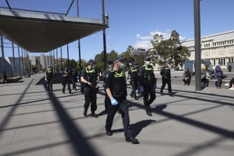 Police arrived at the Melbourne Museum vaccination hub at Carlton Gardens.