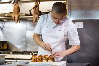 Dan Hong refines some of his canapes for the Mumm marquee.