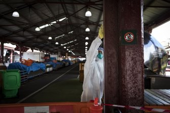 Stalls at Queen Victoria Market being cleaned after it was listed as an exposure site by the Department of Health.