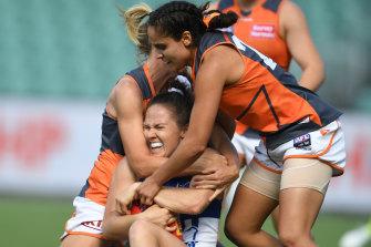North Melbourne's Emma Kearney is tackled.