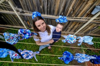Alana Archer- Veith with her nine-  month-old son, Everett, and her stock of reusable nappies.