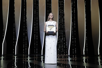 Jodie Foster poses with her honorary Palme d'Or at the opening ceremony of the 74th Cannes Film Festival.