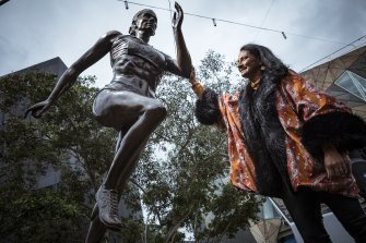 Nova Peris unveils the new statue which immortalises her at Federation Square.