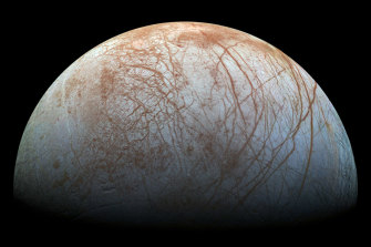 Europa has an ocean trapped beneath an icy surface that spews material into space.