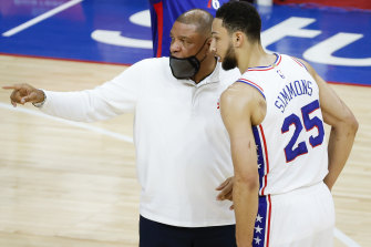 Sixers coach Doc Rivers speaks to Ben Simmons.