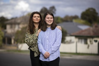 Kylie Kerr with her 13-year-old daughter Lucy at home in Greensborough. On Monday, 12-15 year old children will be eligible for COVID-19 vaccination.