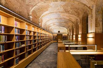 Het Predikheren Library in Belgium was built to incorporate an old Baroque monastery.