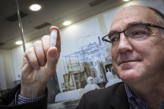 CSL chief scientific officer Andrew Nash with a replica vial of the vaccine.
