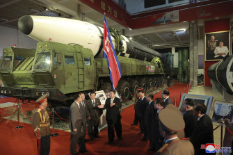 Kim Jong-un in front of what North Korea says is an intercontinental ballistic missile on display in Pyongyang.