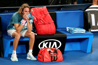 Tsitsipas reacts after beating Roger Federer in 2019 at the Australian Open.