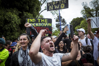 Protesters chanting in Melbourne on Friday.