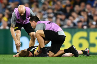 Nick Vlastuin was left concussed and took no further part in the grand final after a collision with Patrick Dangerfield.