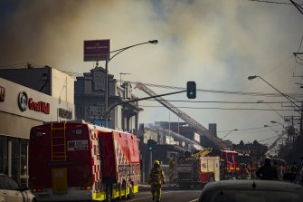 Smoke billowing over the northern suburbs after a factory fire on High Street in Preston on Friday Morning.