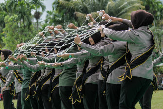 Indonesian women's police officers and women's soldiers took part on a perform traditional dance.