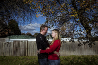Matt McMahon and Kassey Eldridge in their backyard, where they had prepared to marry if restrictions remained tight.