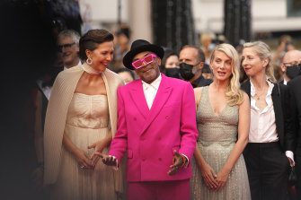 Jury president Spike Lee, second from left, poses with jury members Maggie Gyllenhaal, from left, Melanie Laurent and Jessica Hausner at the premiere of Annette.
