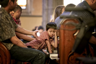 Some struggled to concentrate through the more than hour-long service at St Patrick's.