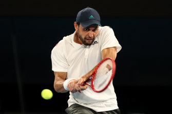Aslan Karatsev is all concentration against Novak Djokovic in their semi-final clash.