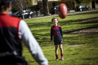 James Dowling and his son Cooper have a kick at the 'G on Sunday.