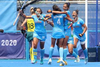 India celebrate scoring against Australia.