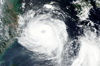 Satellite image released by NASA shows Typhoon Bavi near South Korean island of Jeju on Tuesday.