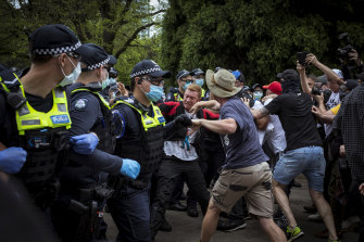 Protesters scuffle with police at the Shrine of Remembrance.