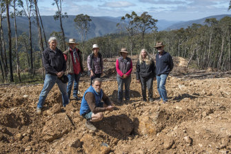 The group stands at the Jones coupe, the first of the 11 to be logged. (Left to right) Ray Anderson, Rhonda Treasure, Louise Crisp, Christa Treasure, Robyn Grant, Bruce Treasure and (front) Johh Hermans.