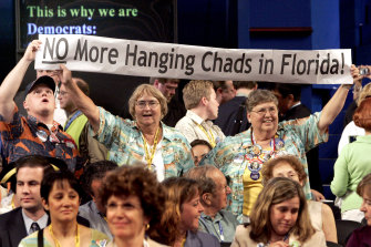 "Democratic delegates from Florida express their displeasure with the election results in 2000, arrived at after multiple challenges and fastidious checking of paper ballots for ""hanging chads""."