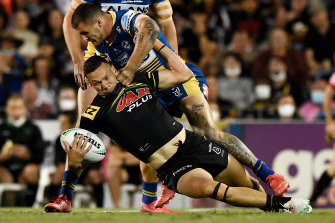 Panthers winger Brent Naden is manhandled by Eels hooker Ray Stone.