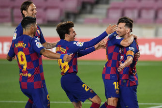 Lionel Messi (right) celebrates his 700th goal for club and country in Barcelona's 2-2 La Liga draw with Atletico Madrid.