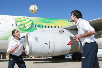 Mark Milligan (left) with Michael Beauchamp at the announcement of the Socceroos squad for the 2006 World Cup.