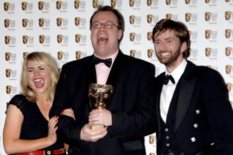 Russell T. Davies (centre) wins a British Academy Television Award in 2006 for Doctor Who alongside stars Billie Piper and David Tennant.
