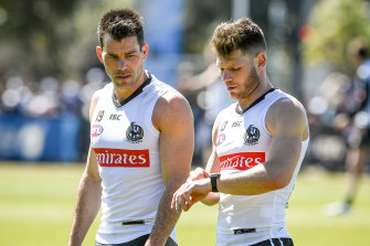 Collingwood's Levi Greenwood (left) with teammate Taylor Adams.