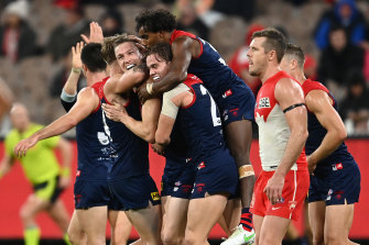 MELBOURNE, AUSTRALIA - MAY 08: Tom McDonald of the Demons is congratulated by team mates after kicking a goal during the round eight AFL match between the Melbourne Demons and the Sydney Swans at Melbourne Cricket Ground on May 08, 2021 in Melbourne, Australia. (Photo by Quinn Rooney/Getty Images)
