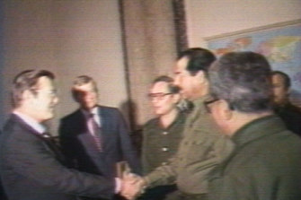 An image taken from a video showing Rumsfeld meeting Saddam Hussein while a special envoy to the Middle East.   Nineteen years later Rumsfeld oversaw the invasion of Iraq.
