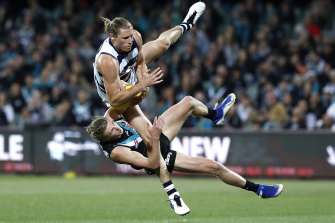 Xavier Duursma bears the brunt in a collision with Geelong's Mark Blicavs.