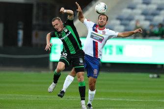 United's Besart Berisha, left, and Benjamin Kantarovski, right, compete for the ball.