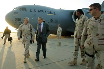Then US secretary of defence Donald Rumsfeld, centre, arrives unannounced at Baghdad International Airport in Baghdad, Iraq, in April 2006.