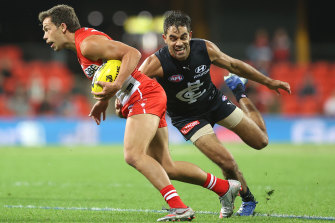 Carlton's Jack Martin chases Oliver Florent of the Swans.
