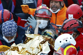 Elif Perincek clings to the thumb of a rescue worker after being pulled from the earthquake rubble in Izmir, Turkey.