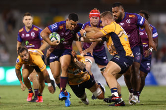 Hunter Paisami of the Reds in action during the round four Super RugbyAU match between the Brumbies and the Reds.