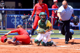Australian catcher Belinda White successfully tags Haylie McCleney out at the plate.