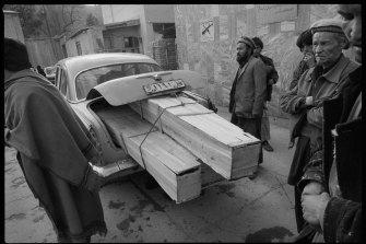 Taxi delivering coffins, Jamhuriat Hospital, Kabul, 1993.